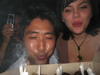 Adults blowing out candles